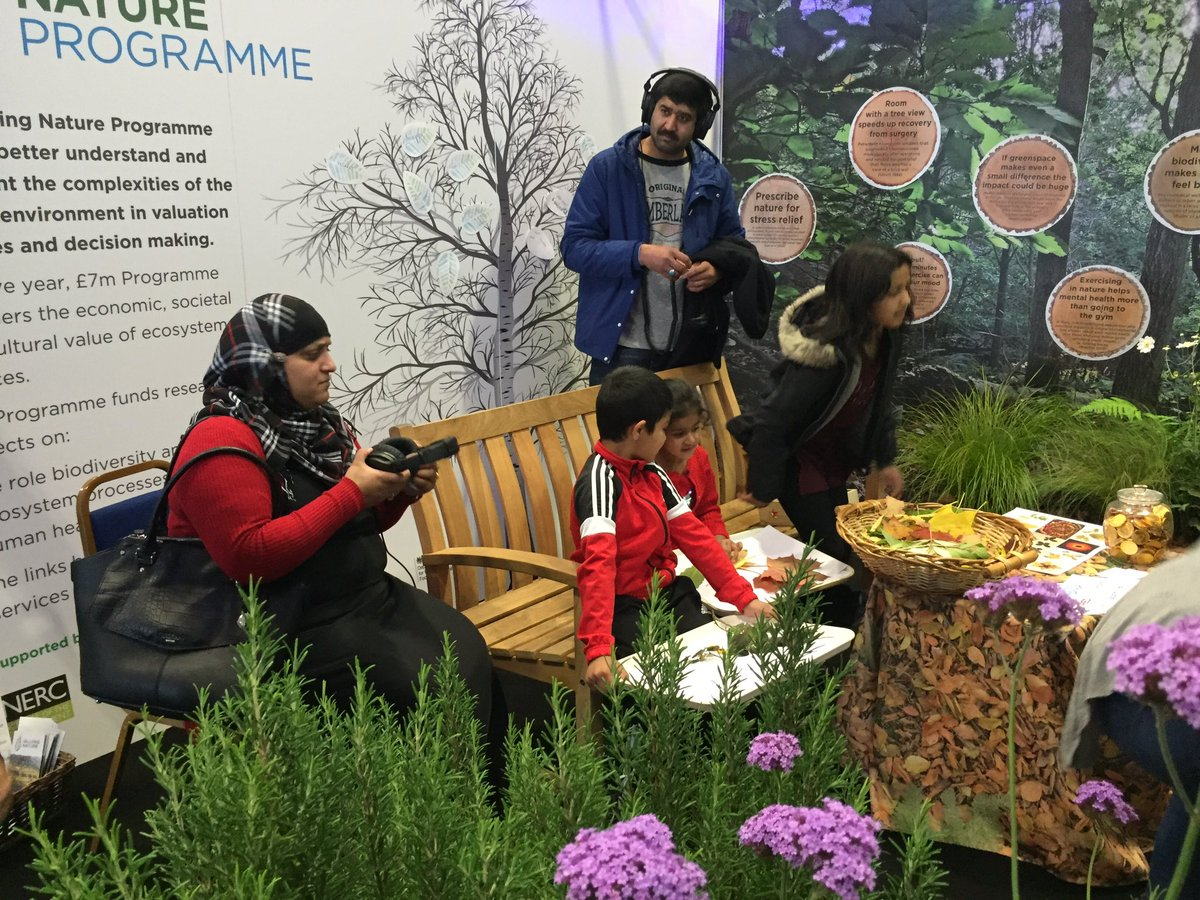 Visitors to Valuing Nature stand at Into the Blue