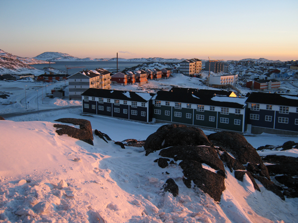 The population of Greenland is 56,000 and rising. Nuuk, the capital is expanding rapidly. There is an acute shortage of housing, so a lot of new apartment blocks like these are being built. (Photo by Andy Sier)