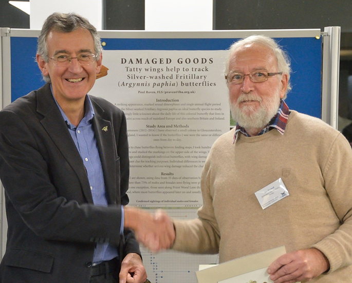 Ian Woiwood collects a butterfly print from Martin Warren at the UKBMS 40th anniversary symposium