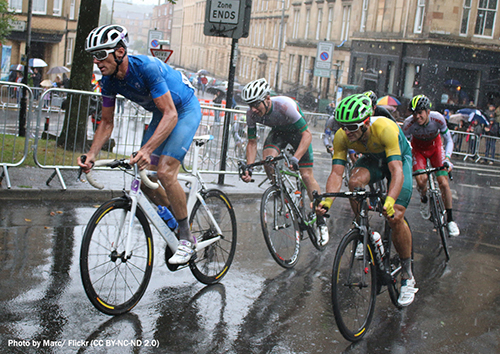Cyclists competing during rain