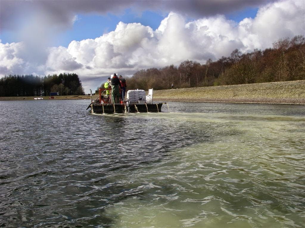 CEH scientists carrying out restoration research at a lake in Scotland