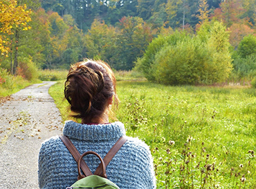 Woman looking at trees