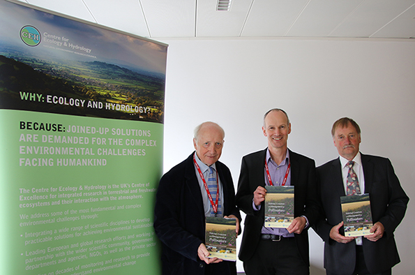 Lord Selborne, Richard Pywell and Marek Nowakowski with copies of Habitat Creation and Management for Pollinators