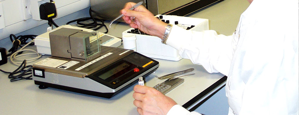 Researcher measuring isotopes