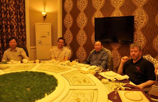 Zhang, Sweetman, Yonglong Lu and Lofts awaiting dinner at the Blue Whale Hotel, Zhangjiakou