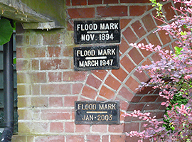 Historical flood marks on the side of a house