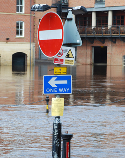 Street sign in a flooded town centre, image by Shutterstock