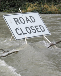 Road closed sign during a flood c. Shutterstock