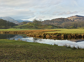Lake District scene with river and fields