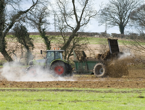 A tractor spreading fertiliser. Photo Christopher Elwell/Shutterstock.