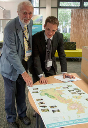 CEH Fellow John Rodda and current NRFA scientist  Harry Dixon sign the commemorative map of  gauging stations. Photo Heather Lowther/CEH