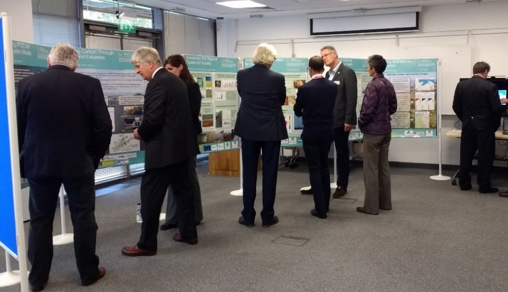 CEH staff and NERC Council members in discussion at the poster board displays