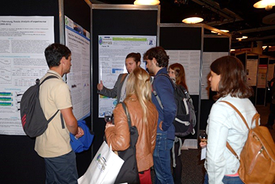 Ozone symposium delegates discussing the conference posters