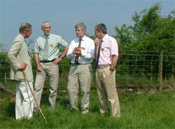 HRH The Prince of Wales talking (from left to right) to Brian Reynolds (CEH Bangor), Bob Vaughan (Environment Agency) and Roger Thomas (Countryside Council for Wales)