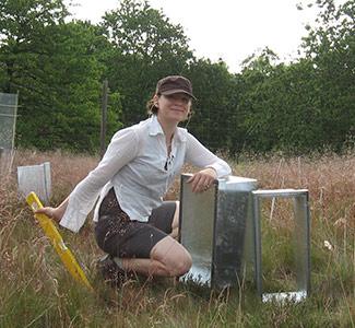 Woman kneeling in a field