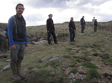 UKCEH staff and volunteers counting occupied puffin burrows for 2013 Isle of May survey