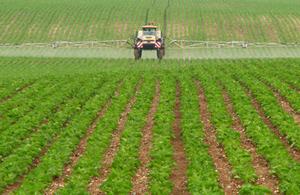 Tractor fertilising a field