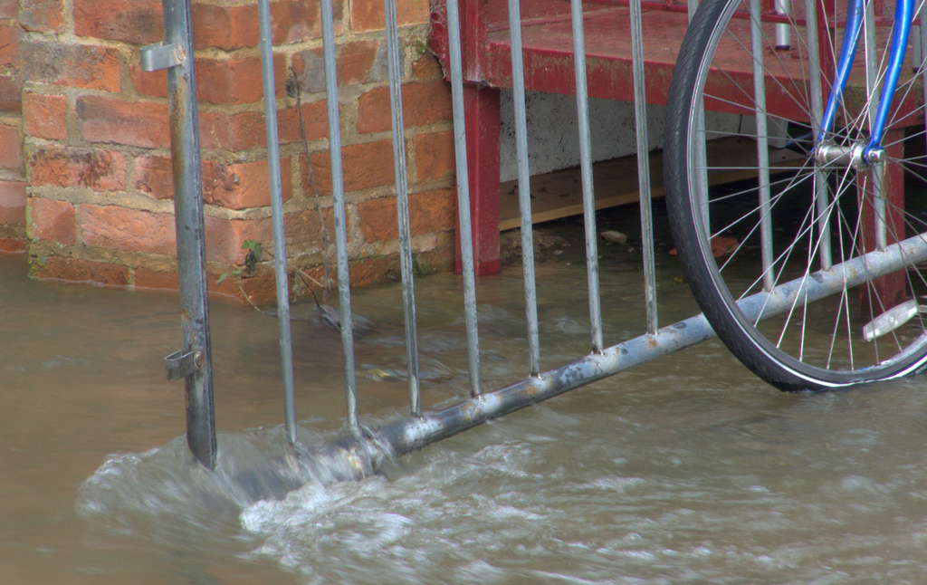 Flood rushing past a gate