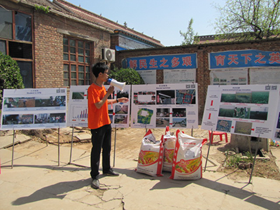 Presentation in front of poster boards by Chinese masters student